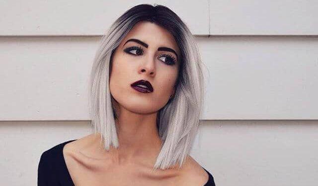 Platinum blonde hair with dark root